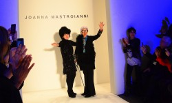 Iris Apfel saying good bye to a standing crowd at the Joanna Mastroianni FW 2012 show